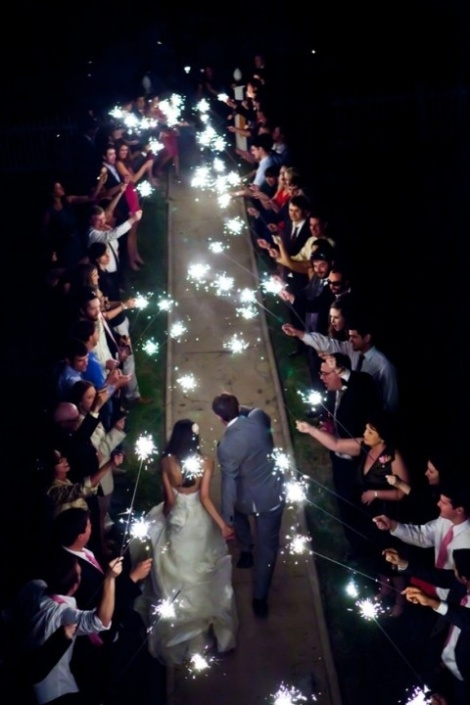 Sparklers as confetti for an evening wedding